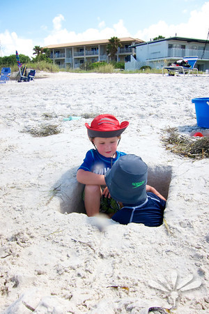 two boys in a hole