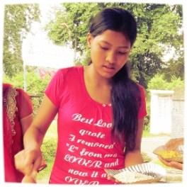 Rabina Shrestha enjoying snacks during a Didi program