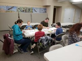 Families creating snowscapes during family crafternoon
