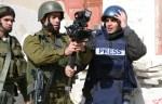 israeli soldier accosts reuters cameraman