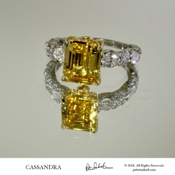 Yellow sapphire and oval diamond ring