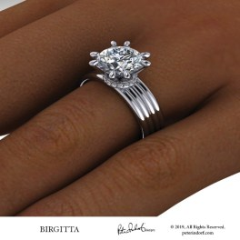 Classic contemporary engagement ring with a wide ridged band and 8 prongs.