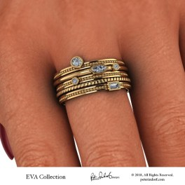 Five band stacking ring set with bezel set fancy shaped and round diamonds in 18KYG.