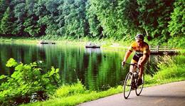 Hometownie Tim Bart in full Hometown Bicycles kit cycling at Kensington Metropark