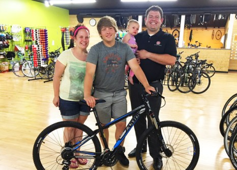 Cameron Hauenstein with his new Jamis Trail X mountain bike that he won from Hometown Bicycles at A Taste of Brighton