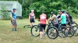 Team Hometown Bicycles' Jean Steinberg teaching students at an MMBA Mountain Bike Skills Clinic near Alpena