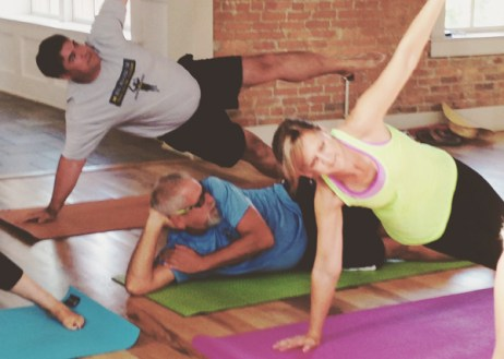 Fred and Kelly Purol doing Vinyasa Yoga with Tocca Massage and Yoga