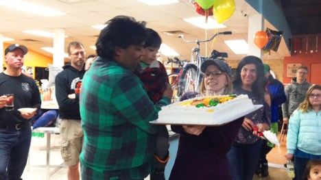 Shaun and Dawn Bhajan with birthday cake at Hometown Bicycles' 3rd Annual Chili Cook-Off