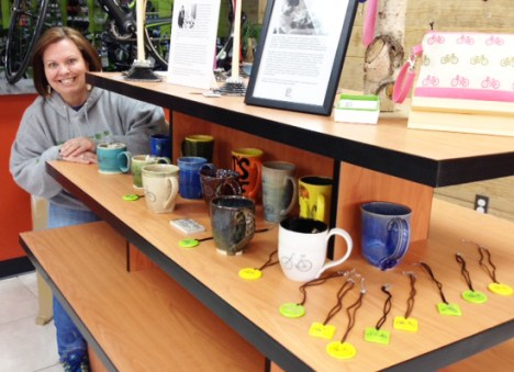 Marla James of Marla's Mud with her hand thrown and hand painted mugs and pendants at Hometown Bicycles