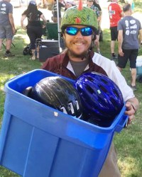 Team Hometown Bicycles Jacob Henrikson donated kids helmets for the PotoMBA's Take a Kid Mountain Biking Day event