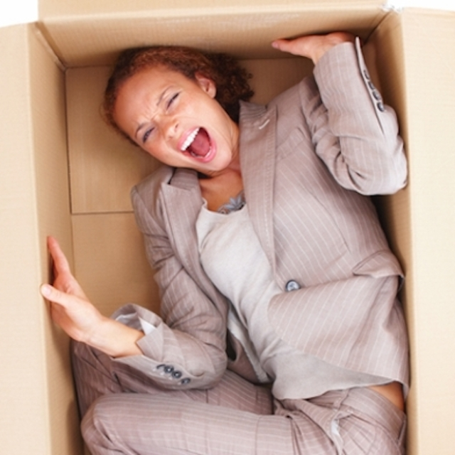 woman business owner trapped in a box