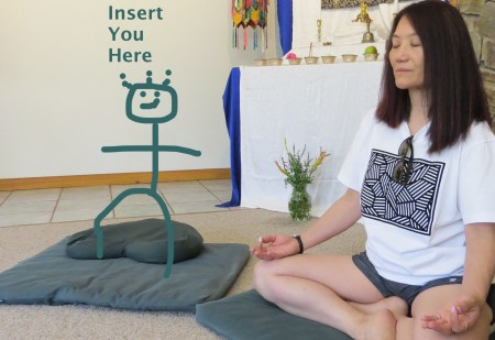 Cute image of stick cartoon figure on a meditation cushion with words Insert You Here, join us in retreat in 2018