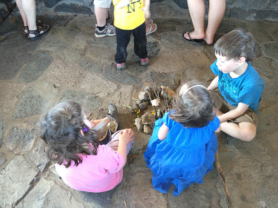 Catherine, Esme and friends building their fairy house