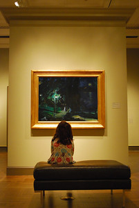 Catherine admires some art