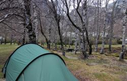 Our tent in a park by a glacial lake