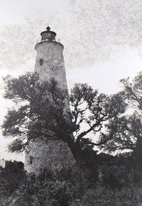 The Ocracoke Island Lighthouse has been a landmark of the NC Outer Banks since 1823. View of the Light through neighboring oak trees. B&W handcrafted alternative process photograph (original silver emulsion print from paper negative). © WJ Eastman Offered by GALLERY5X7