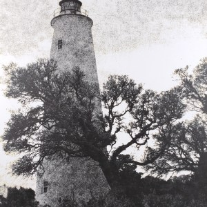 """The Ocracoke Island Lighthouse has been a landmark of the NC Outer Banks since 1823. View of the Light through neighboring oak trees. B&W handcrafted alternative process photograph (original silver emulsion print from paper negative). """"Ocracoke Island Light Oak"""" © WJ Eastman. Offered by GALLERY5X7."""