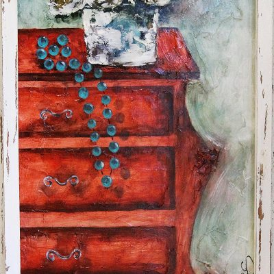 red cupboard with blue necklace and white flowers