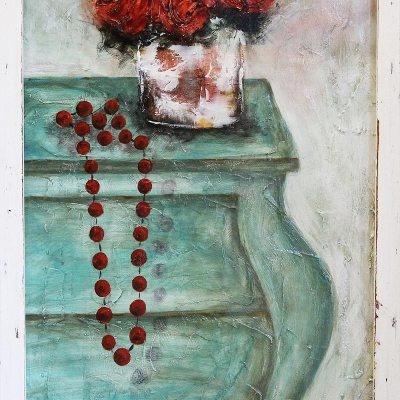 blue cupboard with red necklace and red flowers