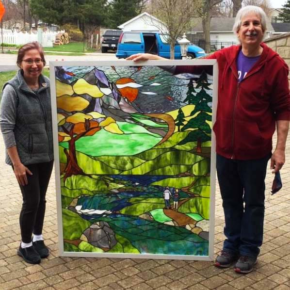 Rose and Bill Jarecki Gallery's Choice with custom Crest Mountain stained glass