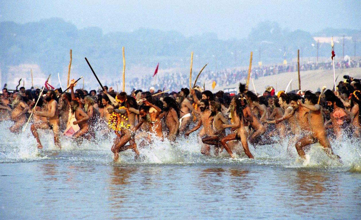 Nagas plunge into Ganges, Allahabad, India 2001