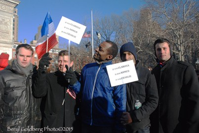 French/Americans (l to r) Julian, Thomas, Placide, Stéphane, Mikael showed up in honor of slain police officers and Charlie Hebdo artists