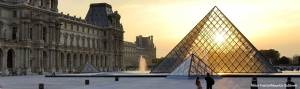 Image of glass pyramid of Louvre at sunsest