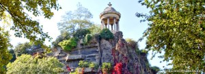 Small temple rotunda on cliff with trees