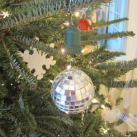 Disco Ball. Years ago my sister Susan surprised me with this. It's always the first ornament on the tree, where it twirls and shimmers endlessly. Thanks Sue!