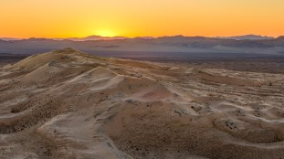"""The Kelso Dunes are notable for the phenomenon known as """"booming dunes"""" when someone slides down slowly, generating a low-frequency rumble that can be both felt and heard."""
