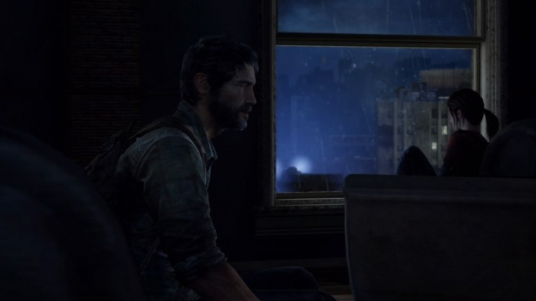 Joel and Ellie silhouetted in moonlight