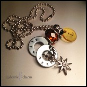 "BALTIC - Mother's necklace with 2 hand-stamped washers. Stainless steel and rhinestone starburst charm, clear acrylic initial disc, amber-colored glass and black rhinestone beads. 24"" stainless steel ball chain. $45 as shown."