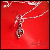 "CLEF - Pewter G clef charm with Swarovski crystal birthstone drop. Pictured with ruby (July). 18"" extra-fine silver-plated cable chain. $20 as shown."