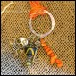 "SKULLOWEEN - Pewter skull and skeleton key charms with black and orange beading, hung on a silver-plated textured ring. 16"" orange ribbon with silver lobster clasp. $25 as shown."