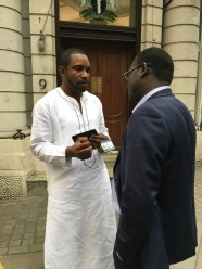 Nigerian embassy staffer talking to Lamin Darboe
