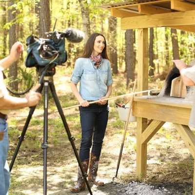 Stacy on Venture Outdoor TV Show making Rustic Bread in Earthen Oven