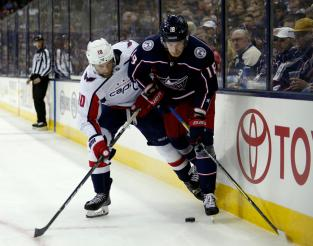 Columbus Blue Jackets forward Pierre-Luc Dubois, right, works against Washington Capitals forward Brett Connolly during the second period in Game 3 of an NHL first-round hockey playoff series in Columbus, Ohio, Tuesday, April 17, 2018. (AP Photo/Paul Vernon)