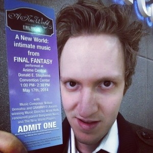 Cody proudly displaying his ticket for A New World: intimate music from FINAL FANTASY at ACEN 2014