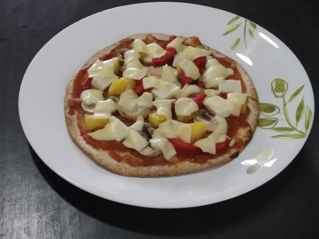 Crispy vegetarian tortilla pizza