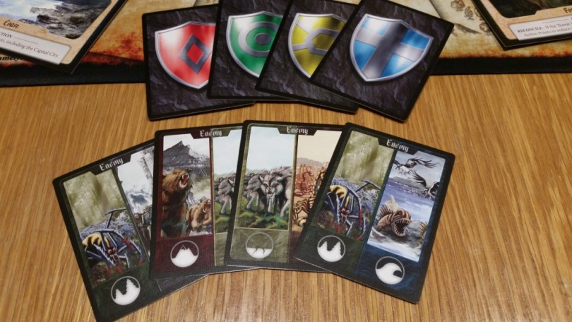 Enemy cards depict the regions that they threaten. Hero cards tell you when you get to actually fight back