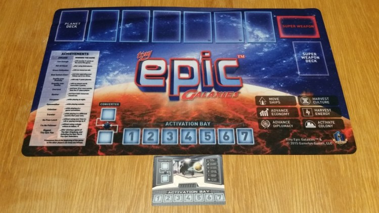 The deluxe playmat is awesome, and the in-box card is awesomely portable! You really can't go wrong with either