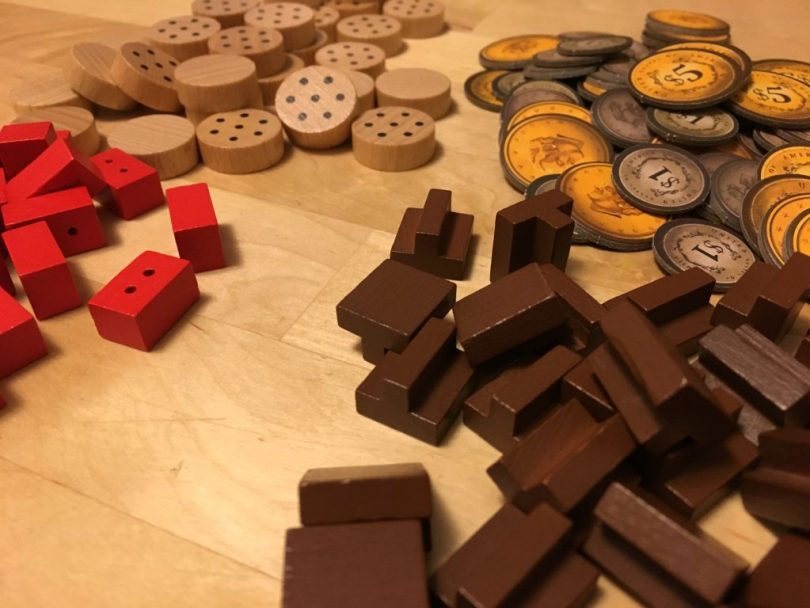 The wood and brick meeples are kind of adorable.