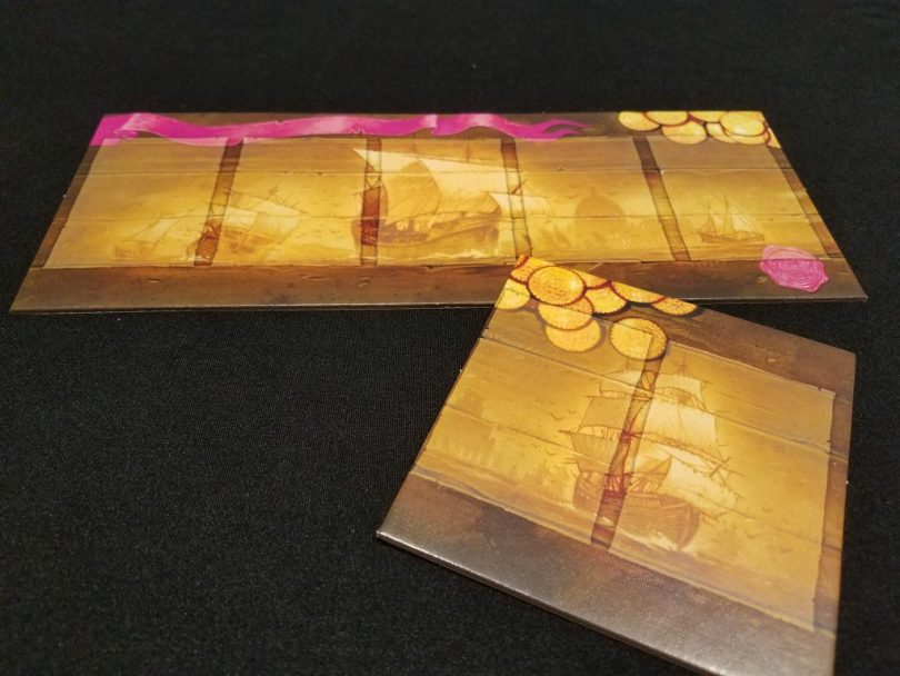 Each player gets a ship board. In the 2-player game, these boards are extended.