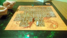 (3 Players) We had a board game day instead of playing Pathfinder this week. As you can tell from this picture of Tsuro, green was already out, and there was no way for red/white to not run into each other. No winner.