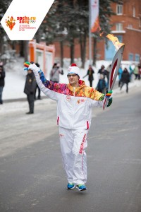 GamesBids.com Producer Robert Livingstone in Sochi 2014 Torch Relay in Khanty-Mansiysk, Russia (©Sochi 2014)