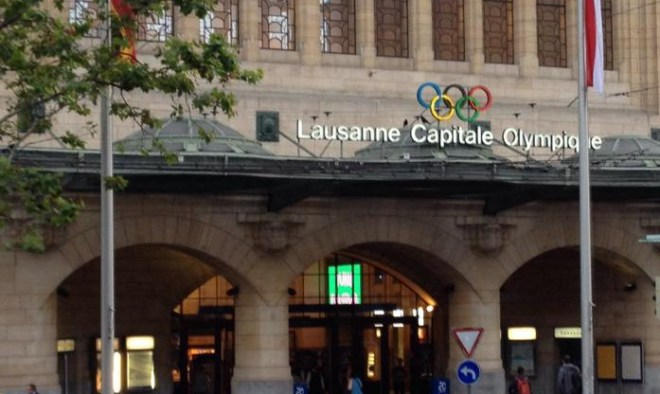 """A sign over the Lausanne Train Station boast its """"Olympic City"""" status (GB Photo)"""