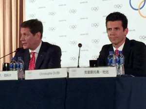 IOC Evaluation Commission Chief Alexander Zhukov and IOC Executive Director Christophe Dubi take questions during press conference in Beijing, March 28, 2015 (GamesBids Photo)