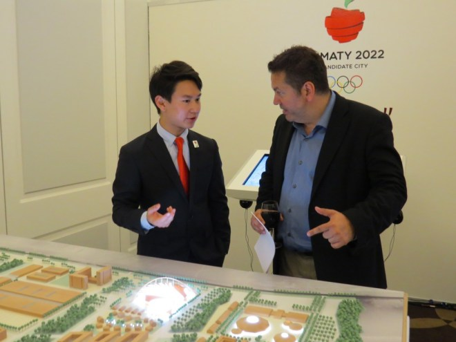 Kazakh Olympic Medalist Denis Ten explains venues to ATR reporter Brian Pinelli (GamesBids Photo)