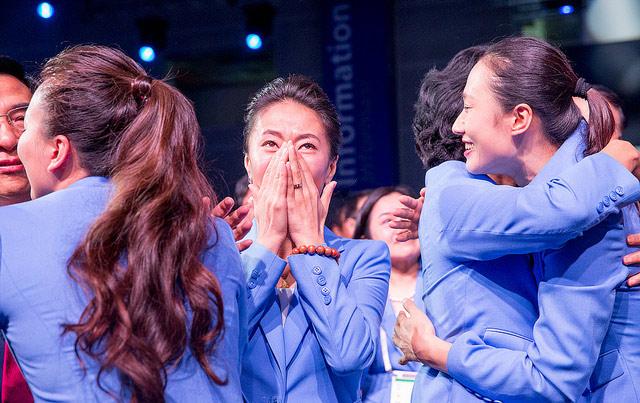 Chinese IOC Member Yang Yang Celebrates as Winning City is Announced (IOC Photo)