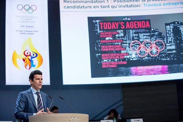 IOC Executive Director Christophe Dubi presents bid changes at 128th IOC Session (IOC Photo)